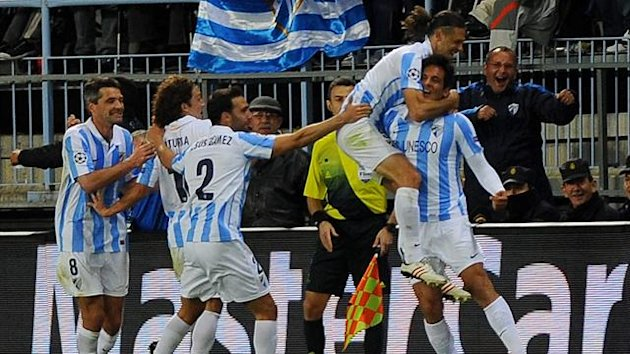 Roque Santa Cruz scores the winner for Malaga (AFP)