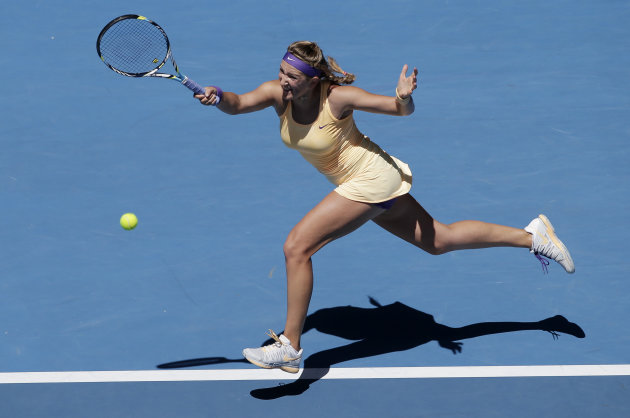 Victoria Azarenka of Belarus hits a forehand return to Russia's Svetlana Kuznetsova during their quarterfinal match at the Australian Open tennis championship in Melbourne, Australia, Wednesday, Jan. 