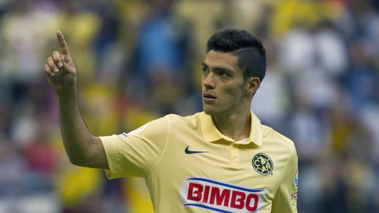 America's Raul Jimenez, celebrates after scoring against Atletico de Madrid during a friendly soccer match in Mexico City, Wednesday, July 30, 2014. (AP Photo/Christian Palma)