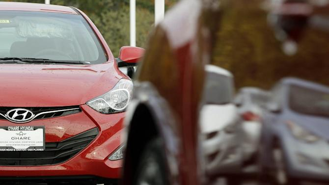 In this  Thursday, Oct. 4, 2012, photo, a Hyundai Elantra is seen inside of a Hyundai car dealership in Des Planines, Ill.  Major automakers are reporting Thursday, Nov. 1, 2012, that sales increased for October despite losing three days of business to the punishing rain and wind from superstorm Sandy. (AP Photo/Nam Y. Huh)