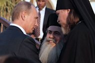 Russian President Vladimir Putin greets Christian religious clergymen after opening a guesthouse for Russia's Christian pilgrims at a Jordan Valley site where many Christians believe Jesus was baptised