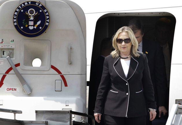 U.S. Secretary of State Hillary Rodham Clinton disembarks from a plane upon arrival in Kolkata, India, Sunday, May 6, 2012. Urging India to reduce the oil it imports from Iran tops U.S. Secretary of State Hillary Rodham Clinton's agenda as she starts two days of talks with Indian officials. (AP Photo/Bikas Das)