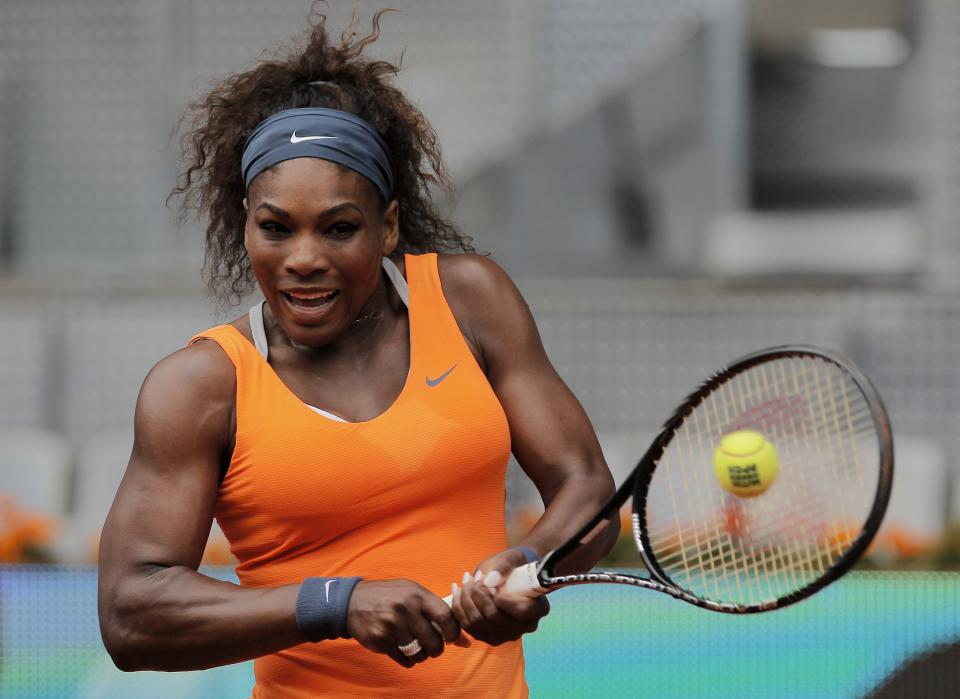 Serena Williams from U.S. returns the ball during the match against Lourdes Dominguez Lino from Spain at the Madrid Open tennis tournament, in Madrid, Tuesday May 7, 2013. (AP Photo/Andres Kudacki)