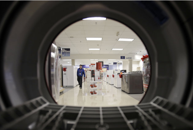 FILE - In this Dec. 6, 2012, photo, an employee walks through the appliance department at a Sears in North Olmsted, Ohio. Sears Holdings Corp. reports quarterly financial results before the market ope