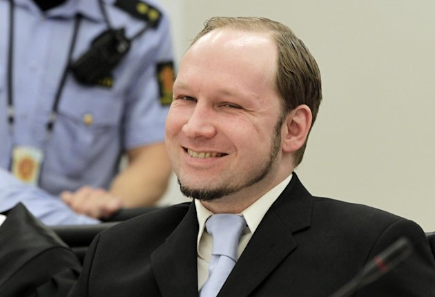 Anders Behring Breivik, the confessed gunman who killed 77 people last year in a bomb and shooting rampage, center, reacts in court as prosecutors deliver their closing arguments in the court in Oslo, Norway Thursday June 21, 2012. (AP Photo/Berit Roald/Scanpix NTB POOL)