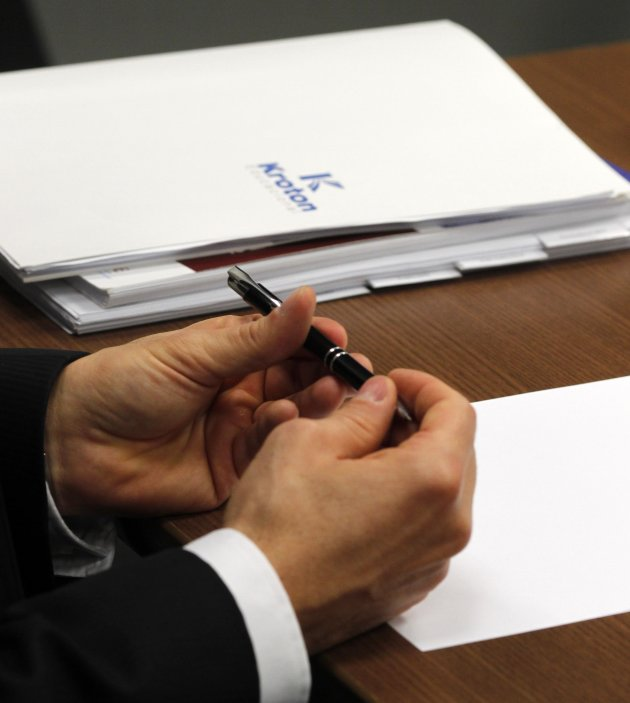 Brazil's Kroton Educacional SA CEO Galindo holds a pen as he attends the Reuters Latin America Investment Summit 2013 in Sao Paulo