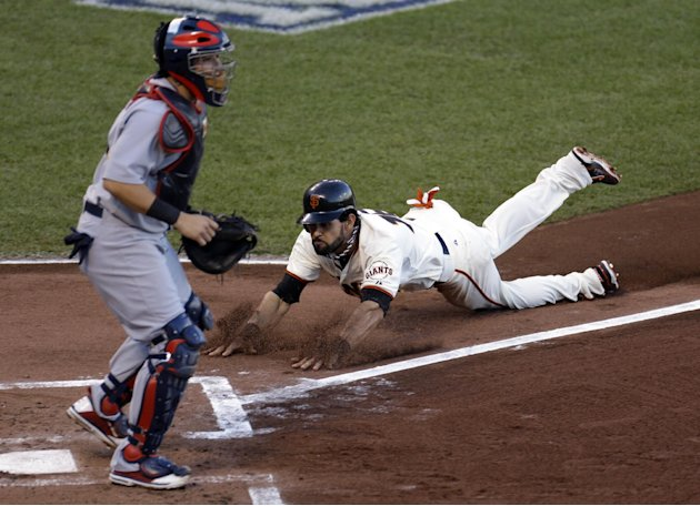San Francisco Giants' Angel Pagan scores past St. Louis Cardinals catcher Yadier Molina during the first inning of Game 7 of baseball's National League championship series Monday, Oct. 22, 2012, in Sa