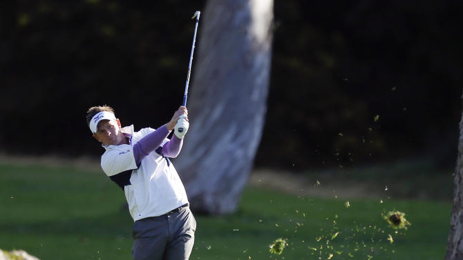 Luke Donald, of England, hits to the 12th green during the first round of the Northern Trust Open golf tournament at Riviera Country Club in Los Angeles, Thursday, Feb. 16, 2012. (AP Photo/Chris Carlson)