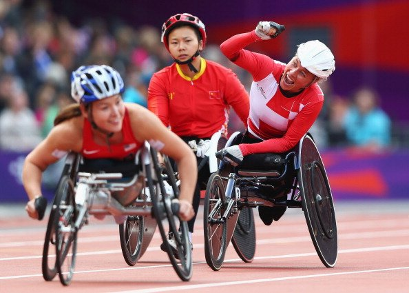 Edith Wolf of Switzerland celebrates winning gold in the Women's 5000m T54 Final on day 4 of the London 2012 Paralympic Games at Olympic Stadium on September 2, 2012 in London, England. (Photo by
