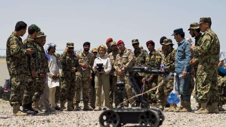 German Defence Minister Ursula von der Leyen drives radio controlled bomb disposal robot at sapper training facility at Camp Shaheen outside Mazar-i-Sharif