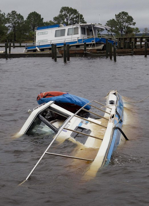 Boats are sunken and thrown up on a dock at the Rock Landing Marina in Panacea, Fla., Tuesday, June 26, 2012. High winds and heavy rains spawned by the approaching Tropical Storm Debby caused the dama