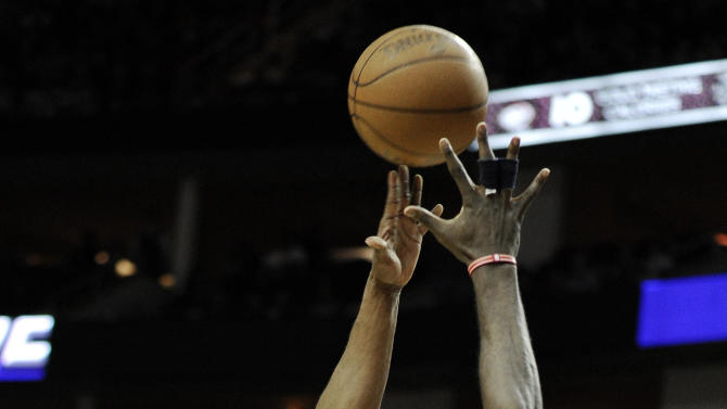 Los Angeles Lakers' Kobe Bryant (24) shoots over Houston Rockets' Patrick Patterson (54) in the first half of an NBA basketball game Tuesday, March 20, 2012, in Houston. (AP Photo/Pat Sullivan)