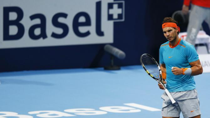 Nadal of Spain reacts after winning his match against France's Herbert at the Swiss Indoors ATP tennis tournament in Basel