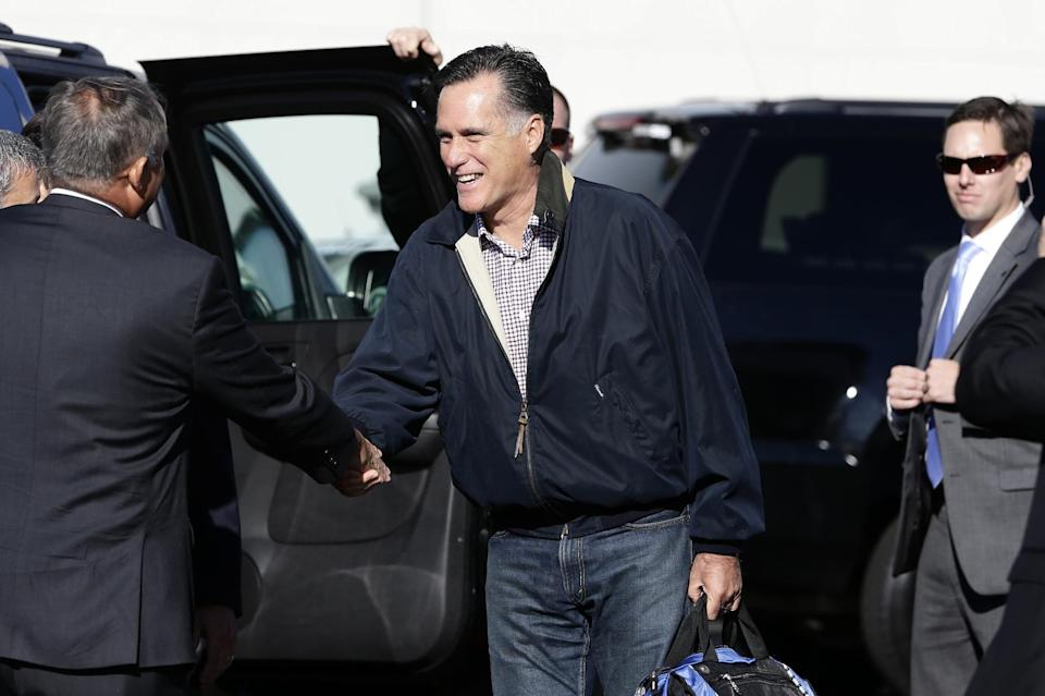 Republican presidential candidate, former Massachusetts Gov. Mitt Romney is greeted as he steps off his campaign plane in Ronkonkoma, N.Y., Tuesday, Oct. 16, 2012, as he arrived for his debate against President Barack Obama. (AP Photo/Charles Dharapak)