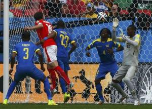 Switzerland's Mehmedi heads the ball to score a goal against Ecuador during their 2014 World Cup Group E soccer match at the Brasilia national stadium in Brasilia