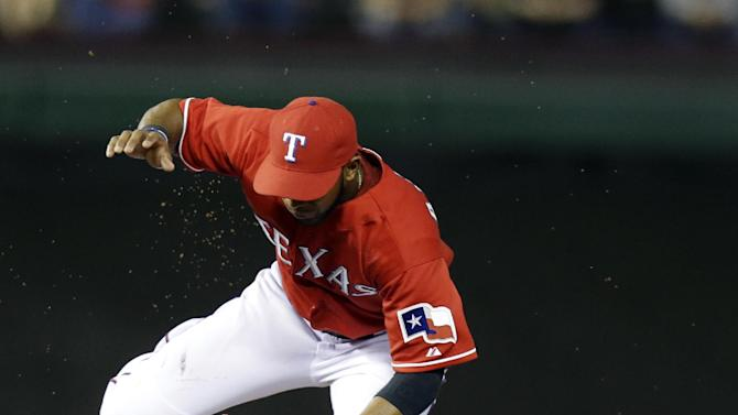 Texas Rangers shortstop Elvis Andrus (1) jumps out of the way as Tampa Bay Rays' Evan Longoria (3) slides to break up the double play during the sixth inning of a baseball game, Monday, April 8, 2013, in Arlington, Texas. (AP Photo/LM Otero)