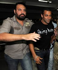 File photo of Indian Bollywood actor Salman Khan (R) with his bodyguard at Ahmedabad airport. They are an essential part of any Bollywood star's entourage, silently shadowing their every move and keeping over-eager fans and a celebrity-obsessed media at a muscular arm's length