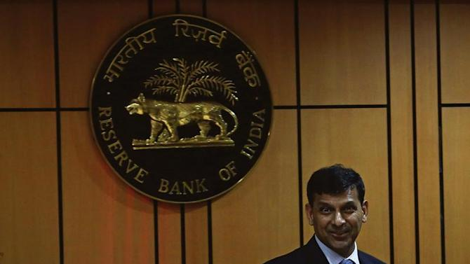Rajan, newly appointed governor of RBI, arrives for a news conference at the bank's headquarters in Mumbai