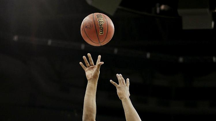 Mississippi guard Ladarius White (10) shoots over La Salle guards D.J. Peterson (1) and Sam Mills (10) during the first half of a third-round game in the NCAA college basketball tournament, Sunday, March 24, 2013, in Kansas City, Mo. (AP Photo/Charlie Riedel)