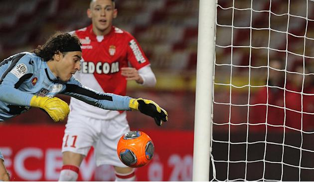 Ajaccio's goalkeeper Guillermo Ochoa of Mexico tries to catch the ball in front of Monaco's Lucas Ocampos of Argentina during their French League One soccer match, in Monaco stadium, Sunday, D