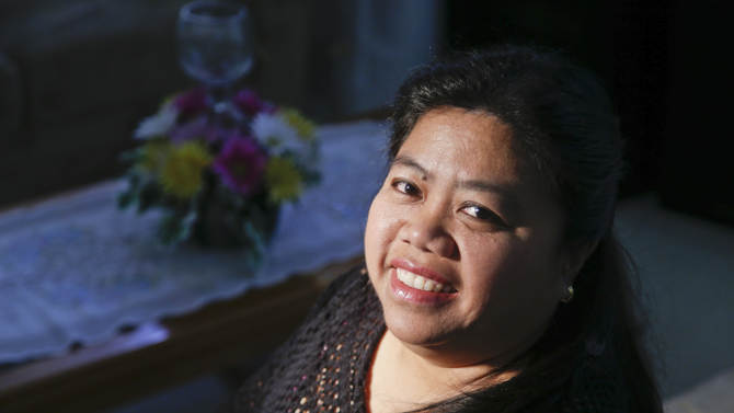 Maricris Arce poses for a picture at her home in Anaheim, Cailf.,Friday, Feb. 15, 2013.  Arce,  a native of the Philippines, said she was separated from her husband for five years after coming legally to the U.S., and he wasn't present for the birth of their first child.  (AP Photo/Chris Carlson)
