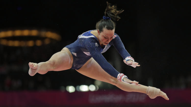 Tweddle Performs On The Uneven Bars During Artistic Gymnastics