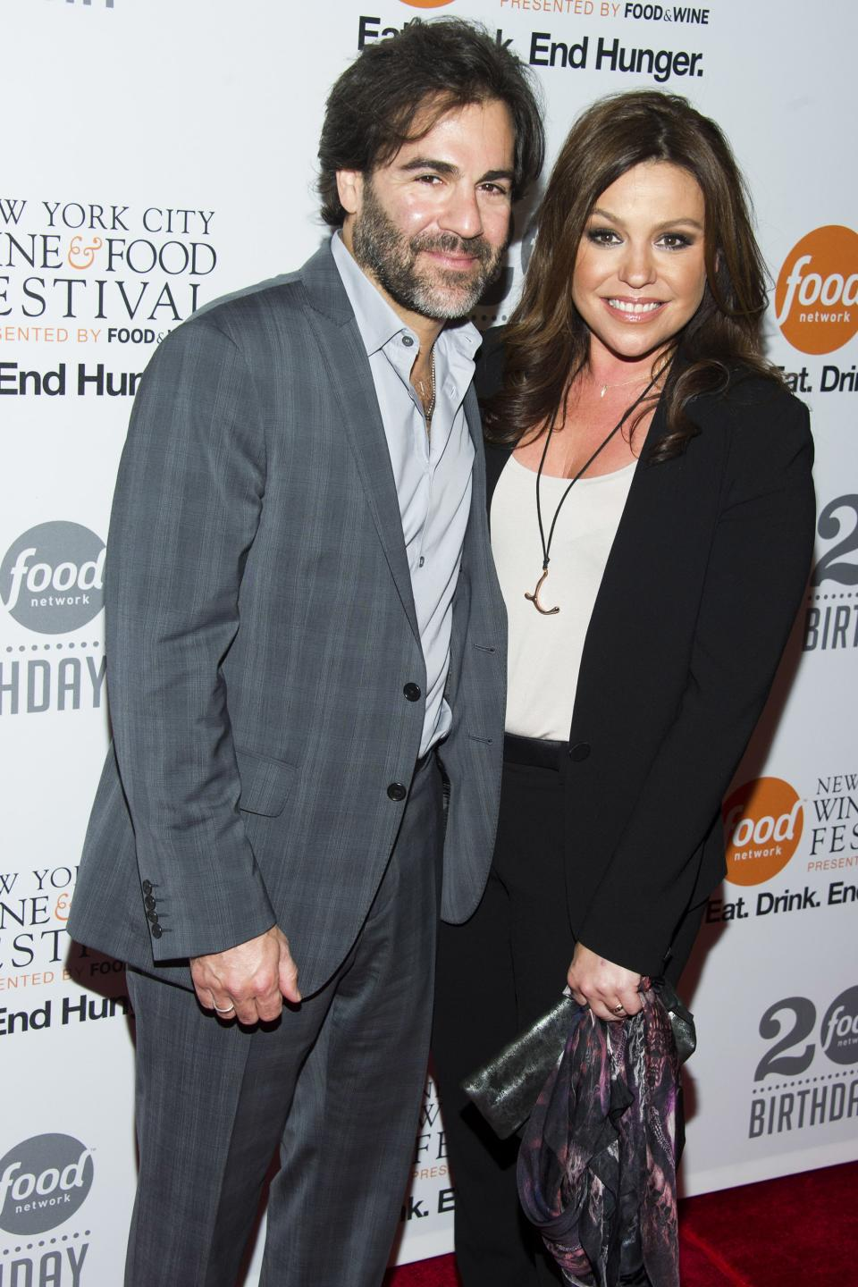 Rachael Ray and her husband John Cusimano attend the Food Network's 20th birthday party on Thursday, Oct. 17, 2013, in New York. (Photo by Charles Sykes/Invision/AP)