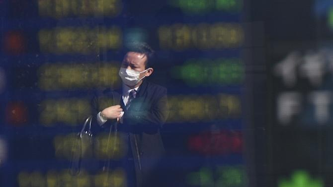 The benchmark Nikkei 225 index at the Tokyo Stock Exchange plunged 5.34%, or 838.74 points, to 14,874.65 at the lunch break, as a stronger yen hammered exporters