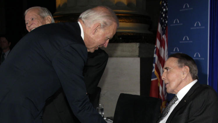 "Vice President Joe Biden, shakes hands with former U.S. Senate Majority Leader  Bob Dole after speaking at ""A Century of Service"" honoring former U.S. Senate Majority Leaders Bob Dole and Howard Baker, behind at left, at Mellon Auditorium, Wednesday, March 21, 2012, in Washington. (AP Photo/Carolyn Kaster)"