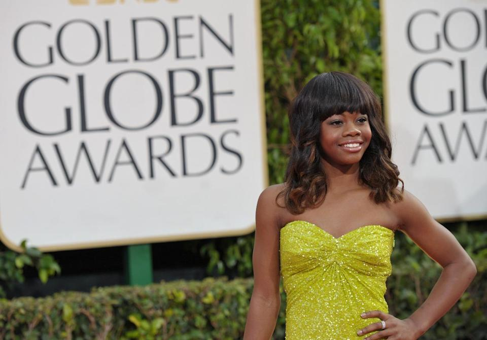 Olympic gymnast Gabby Douglas  arrives at the 70th Annual Golden Globe Awards at the Beverly Hilton Hotel on Sunday Jan. 13, 2013, in Beverly Hills, Calif. (Photo by John Shearer/Invision/AP)