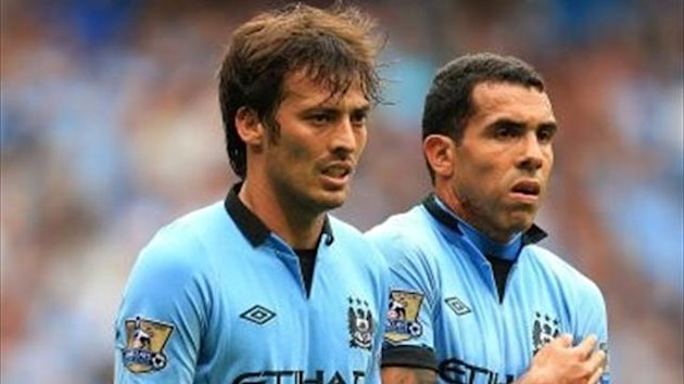 Manchester City's Carlos Tevez (right) and David Silva (left) stand in a wall (PA)