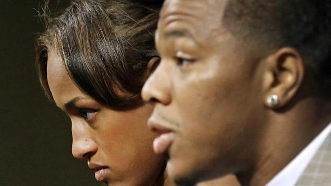 In this May 23, 2014, file photo, Janay Rice, left, looks on as her husband, Baltimore Ravens running back Ray Rice, speaks to the media during a news conference in Owings Mills, Md. The offender-rehabilitation program that former Ravens player Rice entered after knocking Janay unconscious in an Atlantic City elevator is rarely used in domestic assault cases