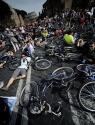 Cyclists take part in a protest rally calling for more and safer bicycle infrastructure, in Rome. Protesters lay down in memory of slain cyclists on the Via dei Fori Imperiali built by fascist dictator Benito Mussolini through the Roman Forum, calling for the busy thoroughfare in Rome's historic centre to be pedestrianised