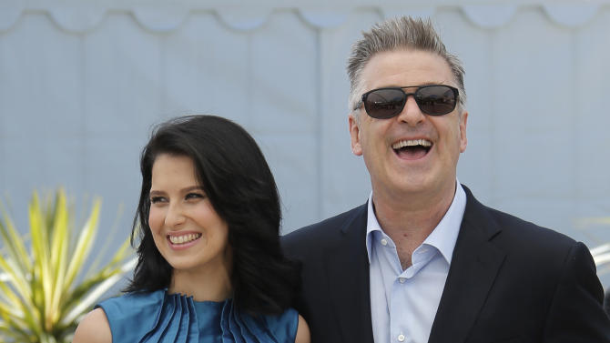 Actor Alec Baldwin, right, and his wife Hilaria Thomas pose for photographers during a photo call for the film Seduced and Abandoned at the 66th international film festival, in Cannes, southern France, Tuesday, May 21, 2013. (AP Photo/Francois Mori)