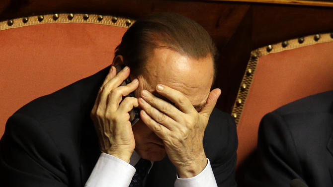 Berlusconi weakened by political about-face