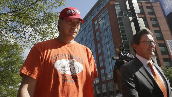 Glenn Adam Chin, left, a former supervisory pharmacist at the New England Compounding Center, walks with his attorney Paul Shaw, right, after appearing in federal court, Thursday, Sept. 4, 2014, in Boston. The pharmacy, which custom-mixed medications in bulk, has been blamed for a 2012 outbreak of fungal meningitis that killed 64 people. Chin was charged with one count of mail fraud, but federal prosecutors said it is part of a larger criminal investigation of Chin and others. (AP Photo/Steven Senne)