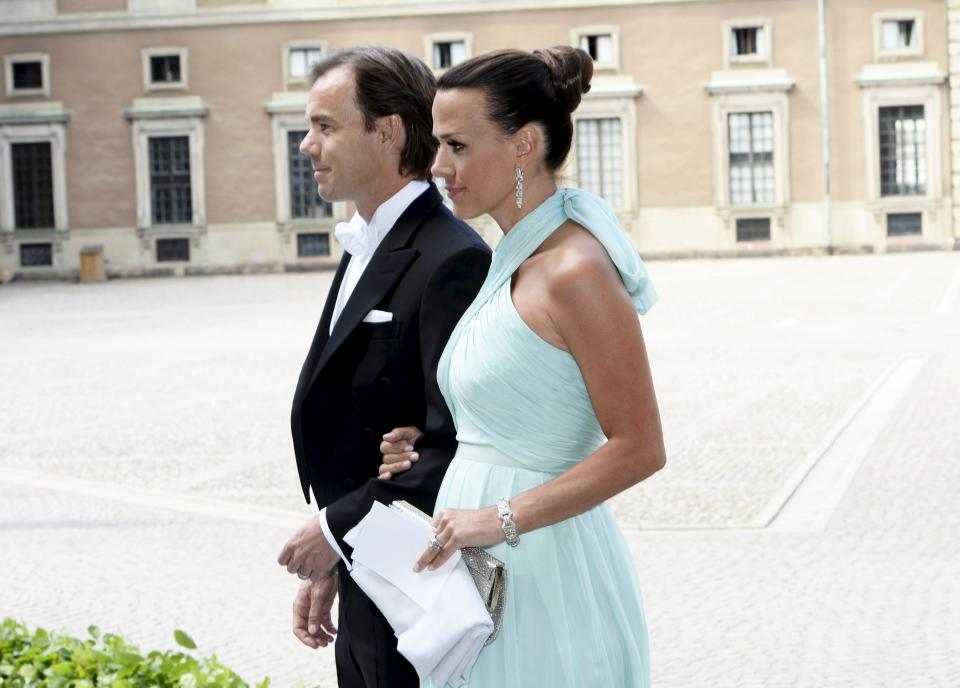CEO of fashion company Hennes & Mauritz (H&M) Karl-Johan Persson and wife Leonie arrive for the wedding of Swedish Princess Madeleine and Christopher O'Neill at the Royal Castle in Stockholm, Saturday June 8, 2013. (AP Photo/Maja Suslin, Scanpix) SWEDEN OUT