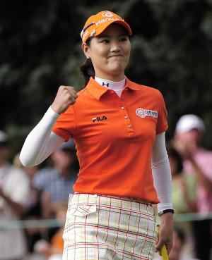 RECROPPED VERSION - So Yeon Ryu, of South Korea, reacts on 18 after forcing a playoff with compatriot Hee Kyung Seo at the Women's U.S. Open golf tournament at the Broadmoor Golf Club, Monday, July 11, 2011, in Colorado Springs, Colo. Ryu won the playoff. (AP Photo/Mark J. Terrill)