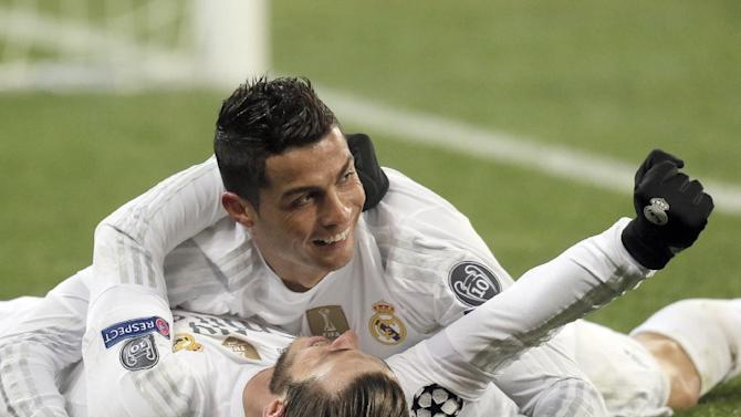Real Madrid's Cristiano Ronaldo, top, celebrate his side's 4th goal with teammate,   Gareth Bale, during the Champions League Group A soccer match between FC Shakhtar and Real Madrid at Arena Lviv stadium in Lviv, Western Ukraine, Wednesday, Nov. 25, 2015. (AP Photo/Efrem Lukatsky)
