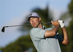 Matt Kuchar follows his ball after teeing off on the 11th hole during Sony Open golf tournament in Honolulu, Hawaii