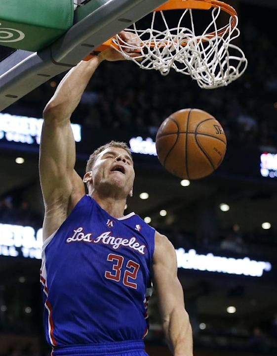 Los Angeles Clippers power forward Blake Griffin (32) dunks against the Boston Celtics in the second half of an NBA basketball game in Boston, Wednesday, Dec. 11, 2013. The Clippers won 96-88