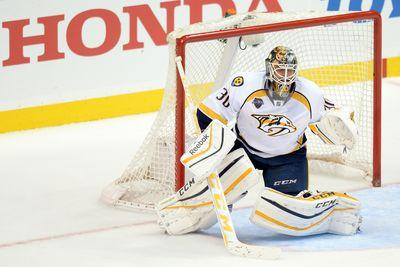 Predators goaltender gets run into like a bowling pin and flips completely over