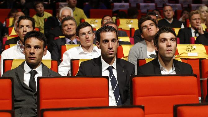Cyclists Jean-Christophe Peraud of France, Vincenzo Nibali of Italy and Thibaut Pinot of France attend the presentation of the itinerary of the 2015 Tour de France cycling race in Paris