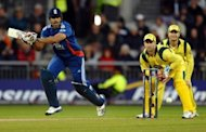 England's Ravi Bopara (L) plays a shot during the fifth One Day Cricket match between England and Australia at Old Trafford in Manchester, England. Bopara starred with bat and ball as England routed Australia by seven wickets to complete a 4-0 series win