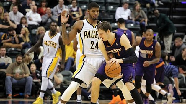 Phoenix Suns guard Goran Dragic (1) is guarded by Indiana Pacers forward Paul George (24) (Reuters)