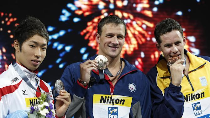 From left: Japan's Kosuke Hagino, silver, Ryan Lochte of the United States, gold, and Brazil's Thiago Pereira, bronze, during the medal ceremony Men's 200m individual medley final at the FINA Swimming World Championships in Barcelona, Spain, Thursday, Aug. 1, 2013. (AP Photo/Michael Sohn)