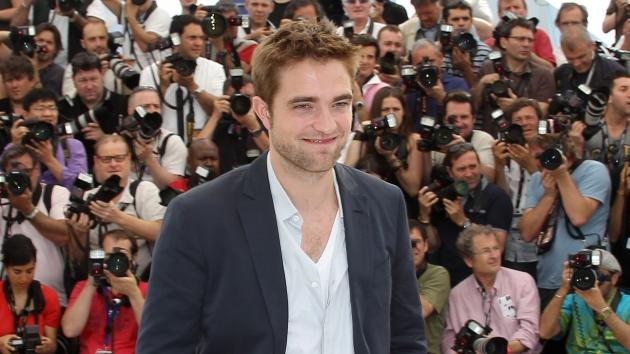 Robert Pattinson is all smiles during the photocall of 'Cosmopolis' presented in competition at the 65th Cannes film festival in Cannes on May 25, 2012 -- Getty Premium