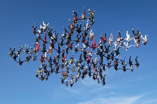 In this image provided by Brian Buckland, 138 skydivers form a massive snowflake formation Friday, Aug. 3, 2012 over Ottawa, Ill. Falling at speeds of up to 220 mph, a group of nearly 140 skydivers shattered the vertical skydiving world record as they flew heads-down in a massive snowflake formation in northern Illinois (AP Photo/Brian Buckland)