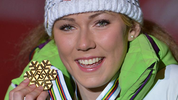 Mikaela Shiffrin, of the United States, poses with the gold medal she won in the women's slalom, at the Alpine Skiing World Championships, in Schladming, Austria, Saturday, Feb. 16, 2013. (AP Photo/Kerstin Joensson)