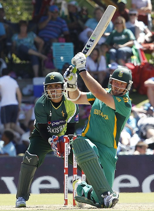 Pakistan's wicket keeper Akmal watches South Africa's Smith play a shot during their one-day international cricket match in Bloemfontein